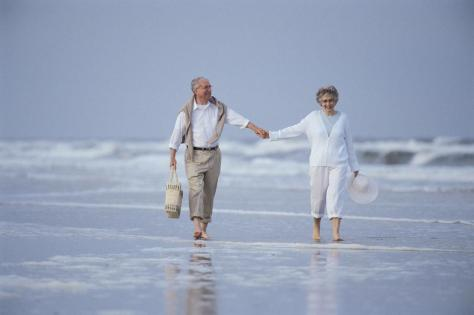 old couple on beach walking_full